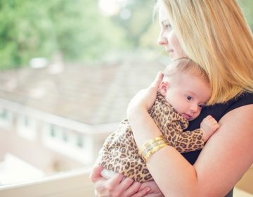 Lisa Abramson and her firstborn child, Lucy, in 2014. A few weeks after Lucy's birth, Abramson started feeling confused, and then started developing delusions — symptoms of postpartum psychosis. (Courtesy of Claire Mulkey)