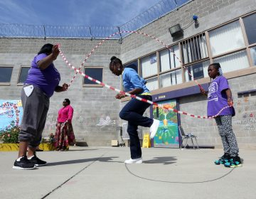 Taryn Mitchell playing with her daughter at Folsom Women's Facility in Folsom Calif. (AP Photo/Rich Pedroncelli)