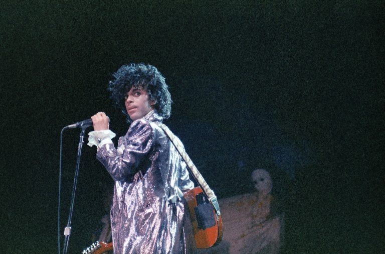 Singer Prince is shown in concert in 1985.  (AP Photo)