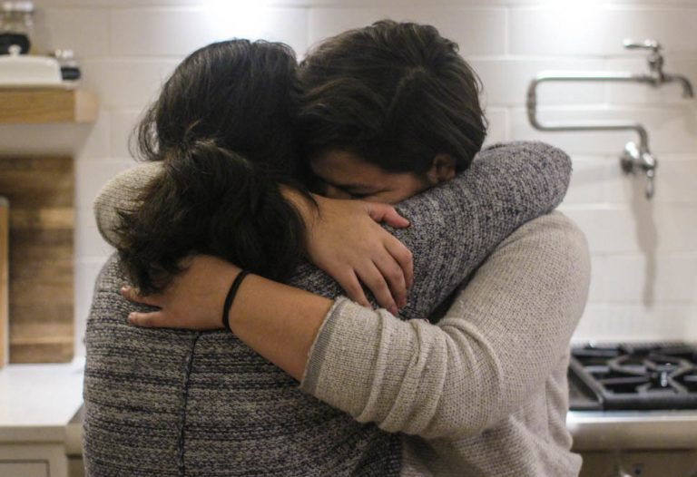 Maria Rivas and her 15-year-old daughter, Emily, embrace after their StoryCorps interview last month. (Mia Warren/StoryCorps)