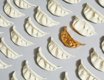 Artist Stephanie Shih remembers making pork-filled dumplings with her family and started her art project by sculpting six of them out of porcelain. She's now made 600. (Robert Bredvad/NPR)