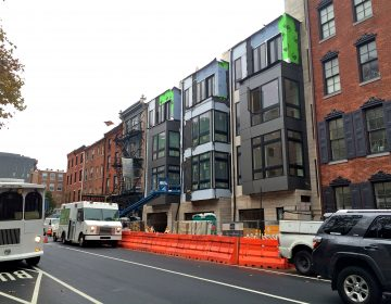Single-family houses with ground floor garages recently rose on the 200 block of Arch Street. (Ashley Hahn/PlanPhilly)