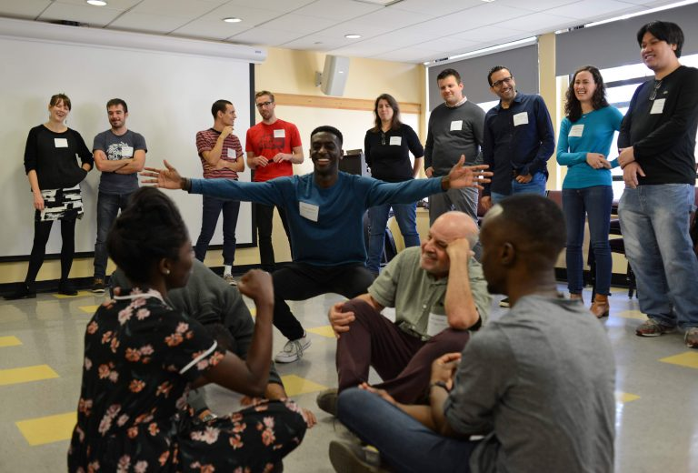 During an icebreaker at the 2018 NYC Stutters conference, attendees play with movement and sound — a treat for those who grew up hating their voices. (Photo courtesy of Paul Isgard)