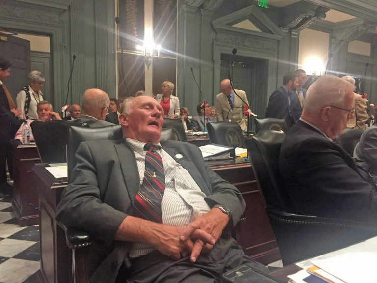 State Rep. Dave Wilson takes an understandable snooze during a recess well past sunrise July 1 in the final legislative session in 2018. (Cris Barrish/WHYY)