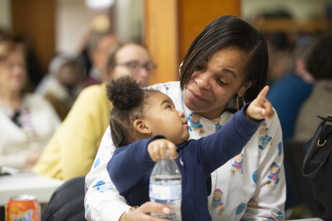 Antoinette Reynolds plays with granddaughter Ma'Leiyah Whitney-Barnes at Uneven Play: A Community Dinner and Conversation held at St. Pauls Lutheran Church in Olney. (Jonathan Wilson for WHYY)