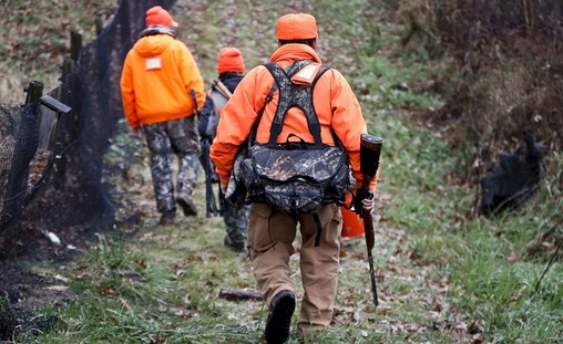 Santo Cerminaro, (right), follows his son, Dominick Cerminaro, (left), and grandson, Santo Cerminaro, 11, into the woods to go deer hunting on the first day of regular firearms deer hunting season, in most of Pennsylvania, Monday, Nov. 26, 2018 in Zelienople, Pa. (Keith Srakocic/AP Photo)