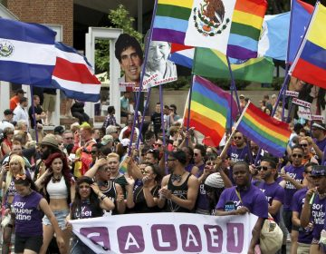In this 2014 photo, people march in the annual Pride Day Parade in Philadelphia. (Joseph Kaczmarek/AP Photo)