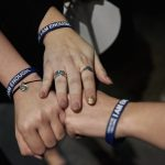 Students who attended Scott Fried's program wear bracelets given to them by Fried that read,