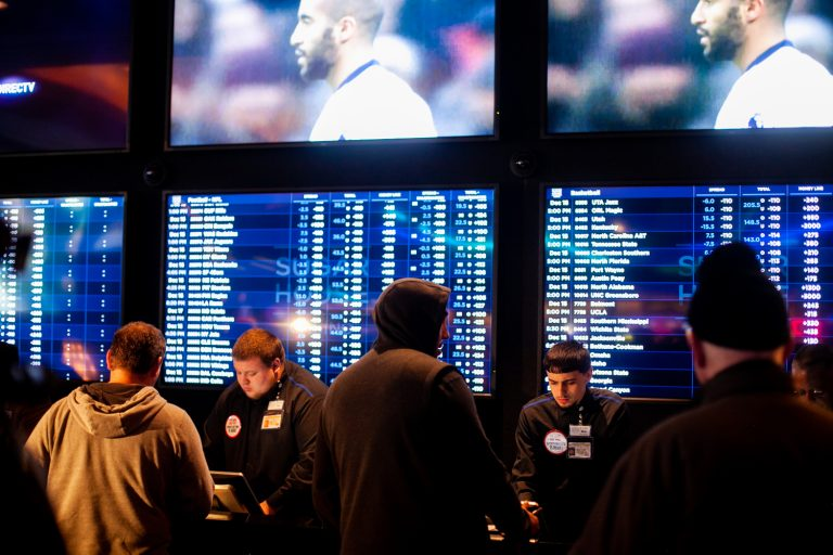 Prospective bettors place their wagers on sports events at the Sugar House Casino. (Brad Larrison for WHYY)