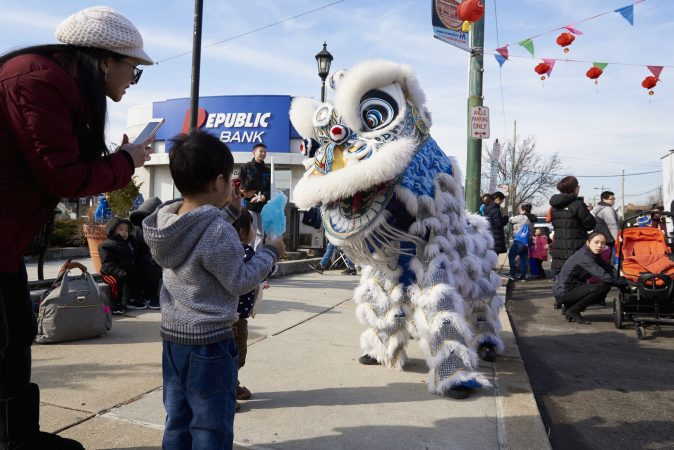 Performers take photos and play with children at the 2019 Chinese New Year Festival in Northeast Philadelphia. (Natalie Piserchio for WHYY)