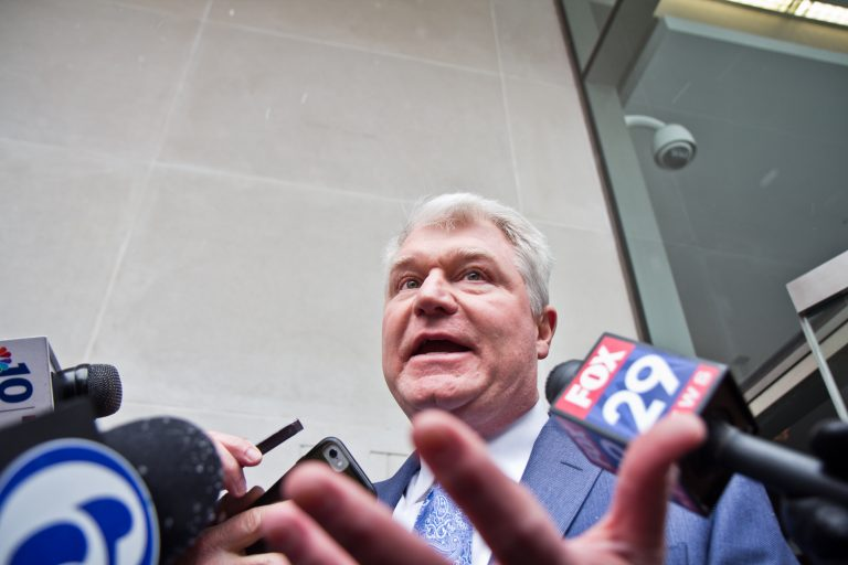 Union Leader John Dougherty exits federal court after he pleaded not guilty at his arraignment Friday afternoon. (Kimberly Paynter/WHYY)