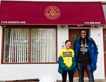 New Sunrise Movement student activists Abby Leddy (left) and Xavier Thomas outside Congressman Dwight Evan's office. They spoke to him about his supporting the Green New Deal. (Kimberly Paynter/WHYY)