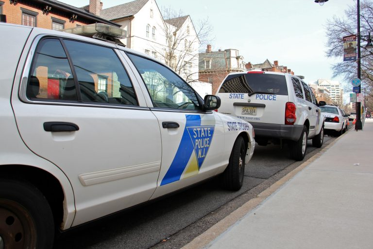 New Jersey State Police cars parked on West State Street, Trenton, outside the capitol complex. (Emma Lee/WHYY)