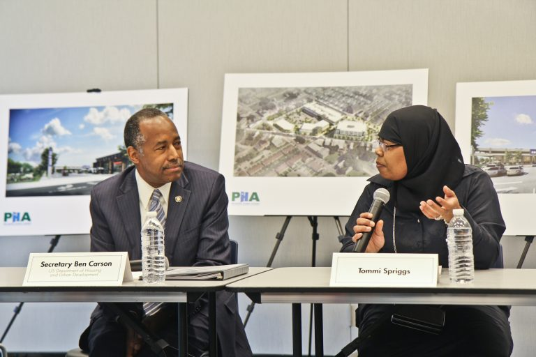 Tommi Spriggs tells her story to Ben Carson, the U.S. Secretary of Housing and Urban Development. (Kimberly Paynter/WHYY)