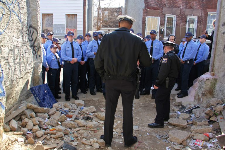 A group of Philadelphia police cadets, touring drug torn Kensington, gather at a vacant lot on East Lippincott Street where their instructors show them signs that heroin is being used there.