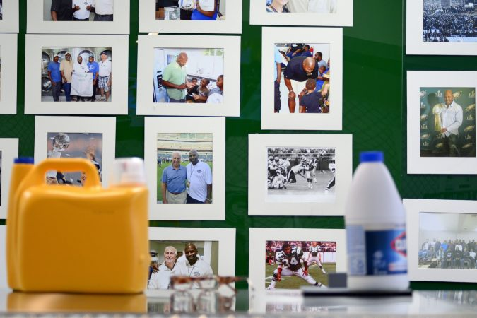 Pictures on the wall remind James Betterson, a former Philadelphia Eagles running back of his football career. He now owns BetterClean Laundry in Northeast Philadelphia. (Bastiaan Slabbers for WHYY)