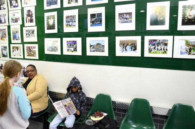 Egypt, 7, reads a book at the laundry library while waiting at the laundromat owned and operated by James Betterson, in Northeast Philadelphia on Feb. 15. (Bastiaan Slabbers for WHYY)