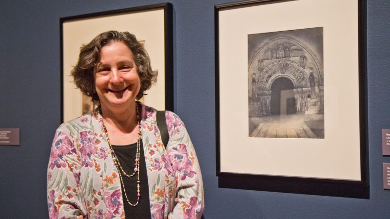 Collector Judy Hochberg with Gustave Le Gray and Auguste Mestral's photograph of the West Portal of the church of Saint-Ours Loches, a blue-toned salt print, 1851. (Kimberly Paynter/WHYY)