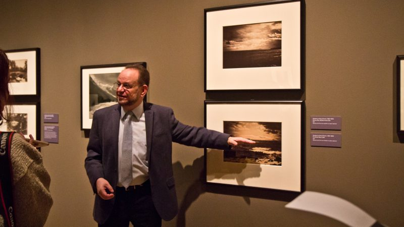 Collector Michael Mattis explains the secret behind the perfectly exposed skiers of Gustave Le Gray's landscape photography. (Kimberly Paynter?WHYY)