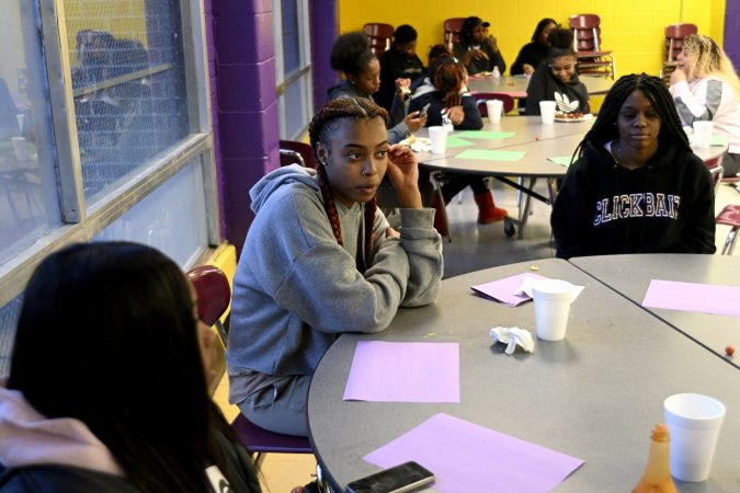 Members of the girls basketball team from MLK and Lankenau High Schools which is coached by Lurline Jones, gather for an end-of-year banquet hosted by coach Lurline Jones, at the cafeteria of MLK HS, in Northwest Philadelphia, Pa., on February 19, 2019. (Bastiaan Slabbers for WHYY)