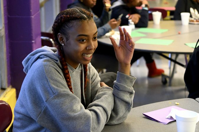 Members of the girls basketball team from MLK and Lankenau High Schools which is coached by Lurline Jones, gather for an end-of-year banquet hosted by coach Lurline Jones, at the cafeteria of MLK Highschool in Northwest Philadelphia, Pa., on February 19, 2019. (Bastiaan Slabbers for WHYY)
