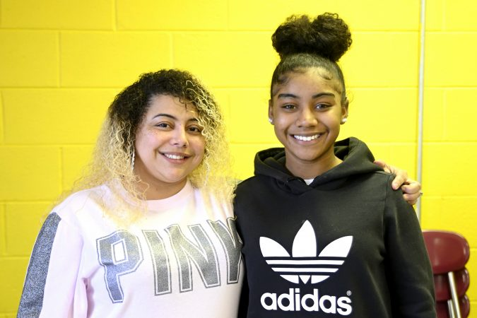 Delilah Santiago and Lankenau freshman Amunique Watson pose at an end-of-year banquet hosted by Coach Lurline Jones at the cafeteria of MLK Highschool, in Northwest Philadelphia, Pa., on February 19, 2019. (Bastiaan Slabbers for WHYY)