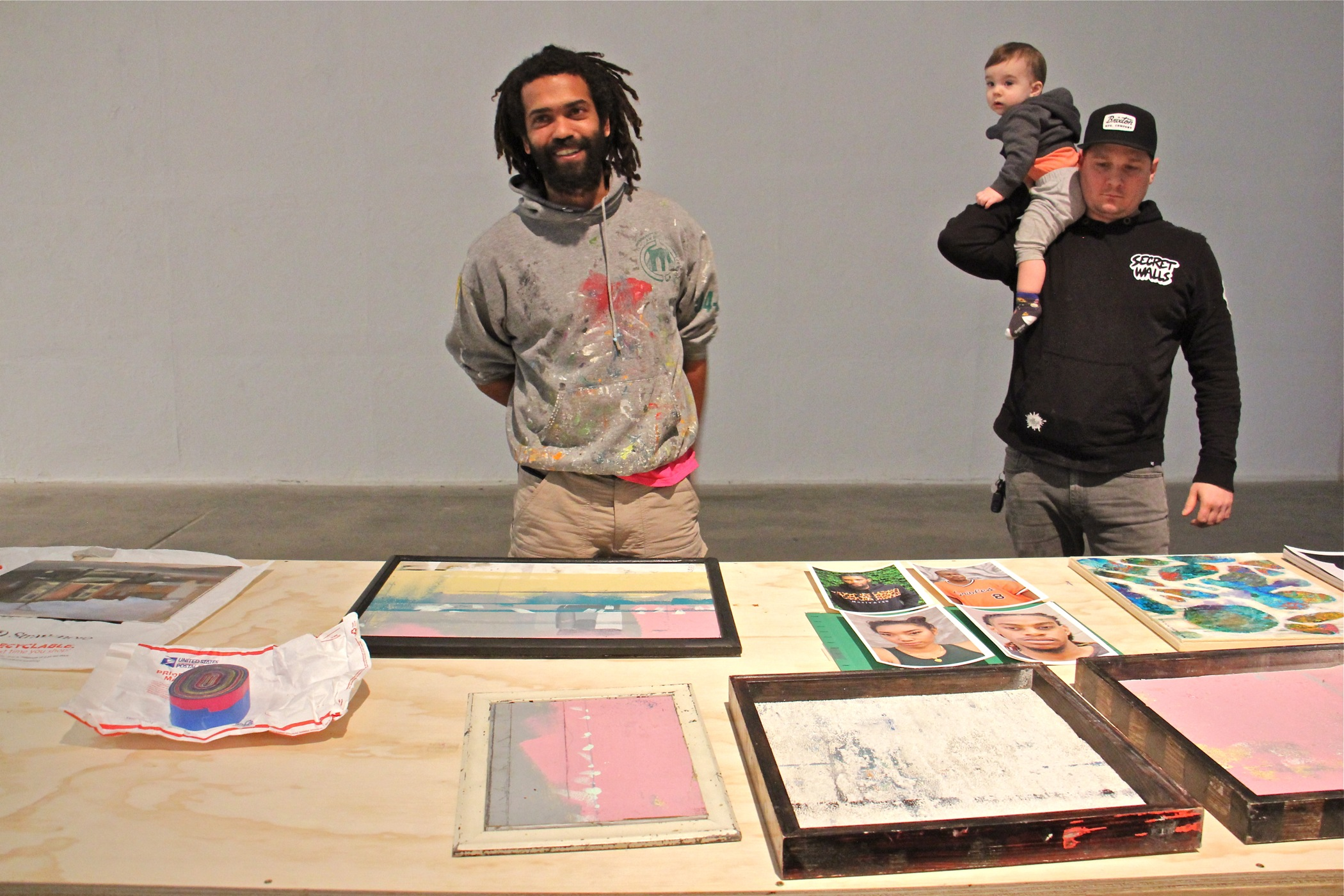 "Keir Johnston (left), of the Philadelphia arts collective Amber Art and Design, collects donated works of art that will be sold to benefit the family of Willis ""Nomo"" Humphrey, who died in November at age 44. He is joined by Philadelphia artist Ben Howard, who dropped off some donated works at the Crane Arts Building."