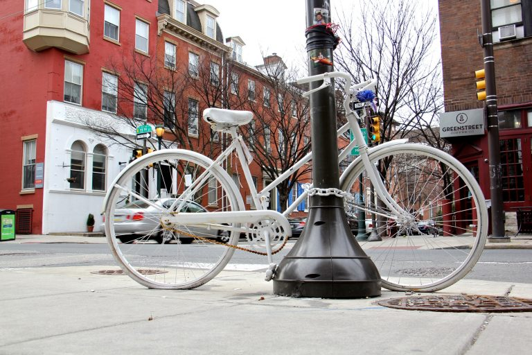 A white bike marks the corner at 11th and Spruce streets where cyclist Emily Fredricks was killed in 2017 (Emma Lee/WHYY)