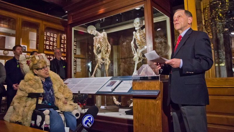 Carol Orzel's best friend Mary (left) and her doctor, Frederick Kaplan, chief of Molecular Orthopaedic Medicine at the University of Pennsylvania, praised Carol for her love of life. Her skeleton is now on display at Philadelphia's Mütter Museum according to her wishes. (Kimberly Paynter/WHYY)