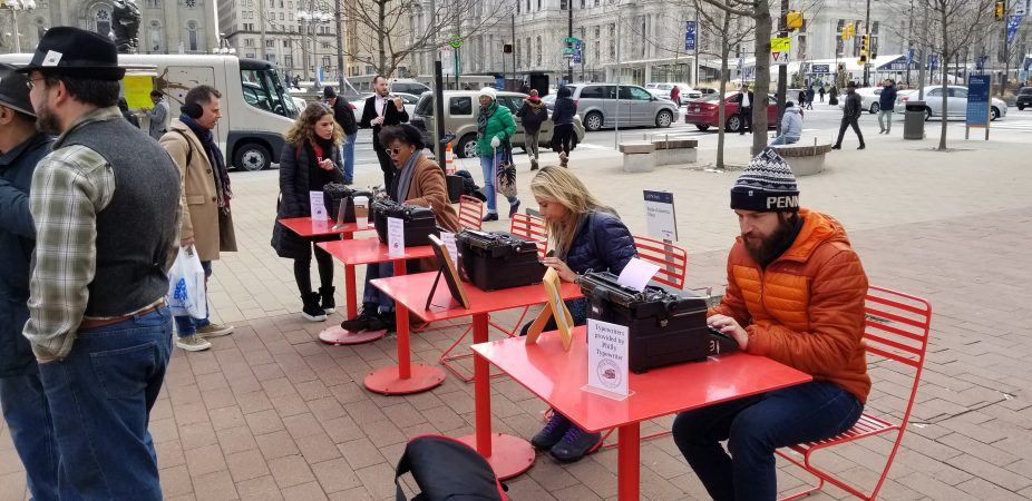 Visitors to LOVE Park type love letters on vintage typewriters. (Tom MacDonald/WHYY)