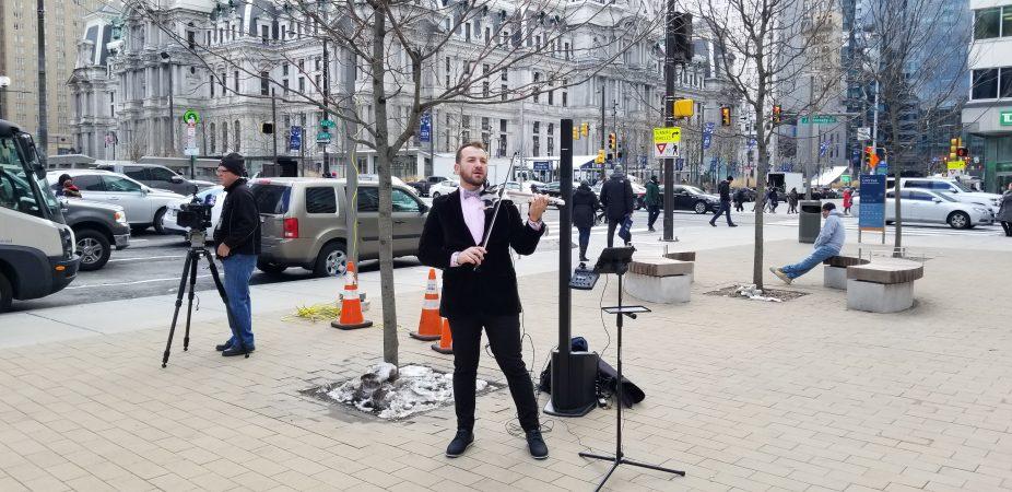 A violinist entertains visitors at LOVE park. (Tom MacDonald/WHYY)