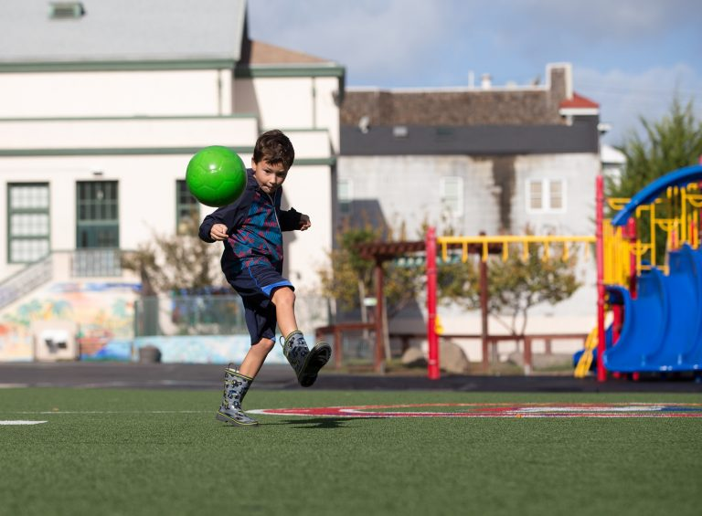Andres Hassan, 7, plays in the yard of the Sanchez Elementary School in San Francisco, Calif. (Lisa Hornak/For WHYY)