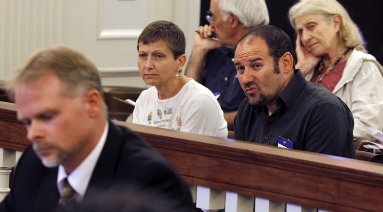 Cathy Katsnelson, second left, and Mark Katsnelson, second right, listen to