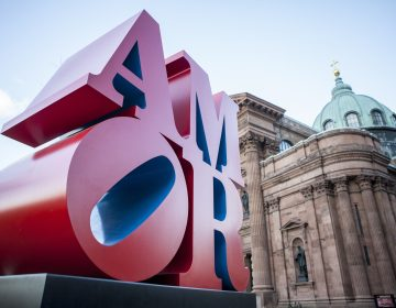 This photo shows Robert Indiana's AMOR sculpture in a park outside Philadelphia's Cathedral Basilica of Saints Peter and Paul, Friday, Dec. 2, 2016. (AP Photo/Michael R. Sisak)