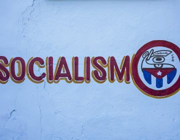 Political propaganda, painted on a street wall, La Habana, Cuba (Lucas Vallecillos/VWPics via AP Images)