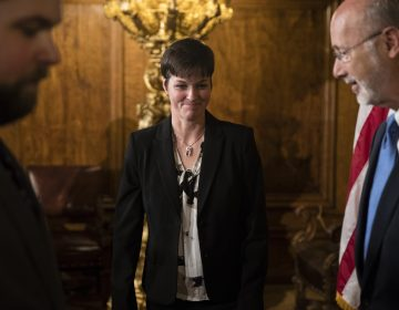 Teresa Miller, center, accompanied by Gov. Tom Wolf, right, depart a news conference at the Pennsylvania Capitol in Harrisburg, Pa., Tuesday, May 23, 2017. (Matt Rourke/AP Photo)