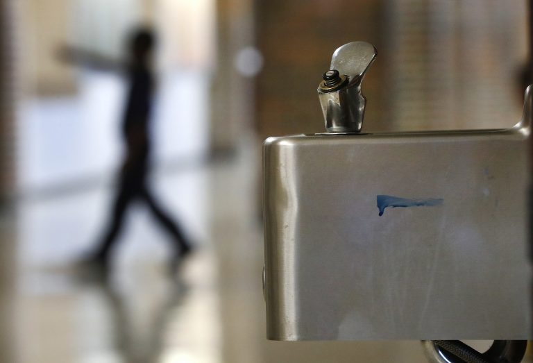 A student walks in the hallway past a water fountain at Noble School in Detroit, Tuesday, Sept. 4, 2018. (Paul Sancya/AP Photo)