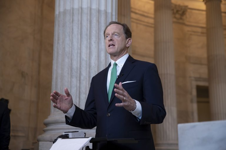 Sen. Pat Toomey, R-Pa., discusses President Donald Trump's revamped North American trade agreement with Canada and Mexico during a television news interview on Capitol Hill in Washington, Tuesday, Oct. 2, 2018. (J. Scott Applewhite/AP Photo)