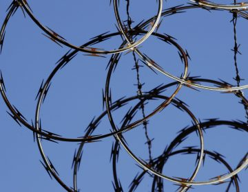 In this Tuesday, Oct. 23, 2018 photo, barbed wire lines the top of a wall at the deactivated House of Correction in Philadelphia. (Matt Rourke/AP Photo)