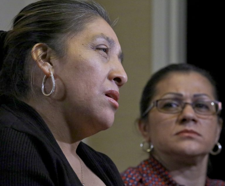Sandra Diaz, (right), listens as Victorina Morales, (left), recalls her experience working at President Donald Trump's golf resort in Bedminster, N.J., during an interview, Friday Dec. 7, 2018, in New York. (Bebeto Matthews/AP Photo)