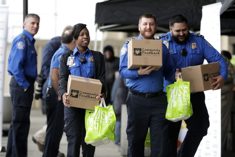 Transportation Security Administration employees carry boxes of non perishables and bags of produce received from the Community Food Bank at a drive at Newark Liberty International Airport to help government employees who are working without pay during the partial government shutdown, Wednesday, Jan. 23, 2019, in Newark, N.J. (Julio Cortez/AP Photo)