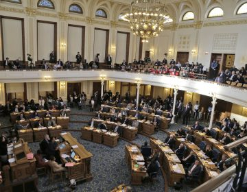 The New Jersey State Assembly votes on raising the minimum wage in Trenton, New Jersey. On Monday, Gov. Phil Murphy signed the legislaton phasing in a $15 hourly wage over five years. (AP Photo/Seth Wenig)