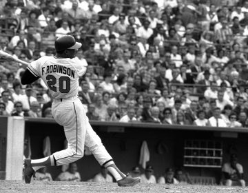 This is a May 19, 1966, file photo showing Baltimore Orioles' Frank Robinson at bat. Hall of Famer Frank Robinson, the first black manager in Major League Baseball and the only player to win the MVP award in both leagues, has died. He was 83. Robinson had been in hospice care at his home in Bel Air. MLB confirmed his death Thursday, Feb. 7, 2019. (AP Photo/File)