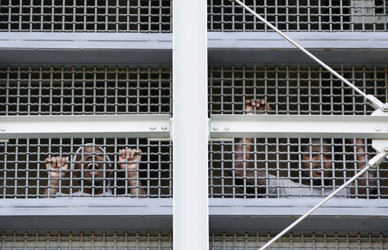 Prisoners call out to protesters and family members gathers outside the Metropolitan Detention Center, a federal prison where prisoners have been without heat, hot water, electricity and proper sanitation due to an electrical failure since earlier in the week, Sunday, Feb. 3, 2019, in the Brooklyn borough of New York. (Kathy Willens/AP Photo)