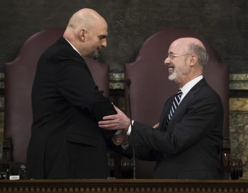 Democratic Gov. Tom Wolf, right, shakes hands with Lt. Gov. John Fetterman before he delivers his budget address for the 2019-20 fiscal year to a joint session of the Pennsylvania House and Senate in Harrisburg, Pa., Tuesday, Feb. 5, 2019. (AP Photo/Matt Rourke)
