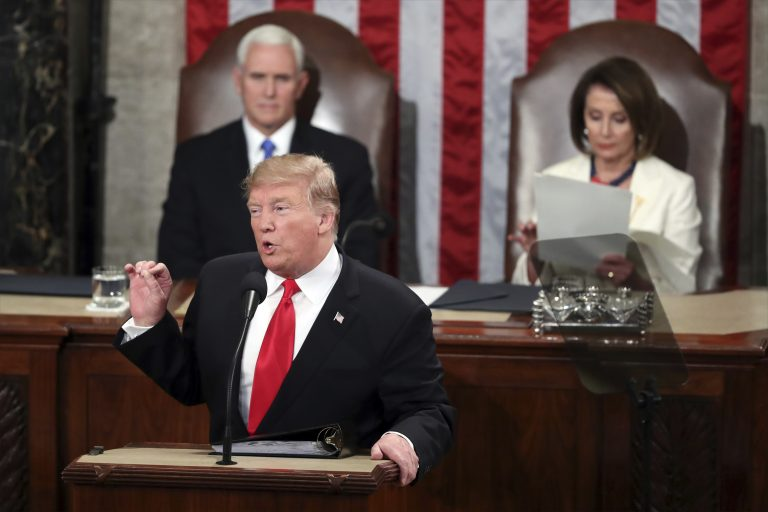 President Donald Trump delivers his State of the Union address to a joint session of Congress on Capitol Hill in Washington, as Vice President Mike Pence listens and Speaker of the House Nancy Pelosi, D-Calif., reads the speech, Tuesday, Feb. 5, 2019. (Andrew Harnik/AP Photo)