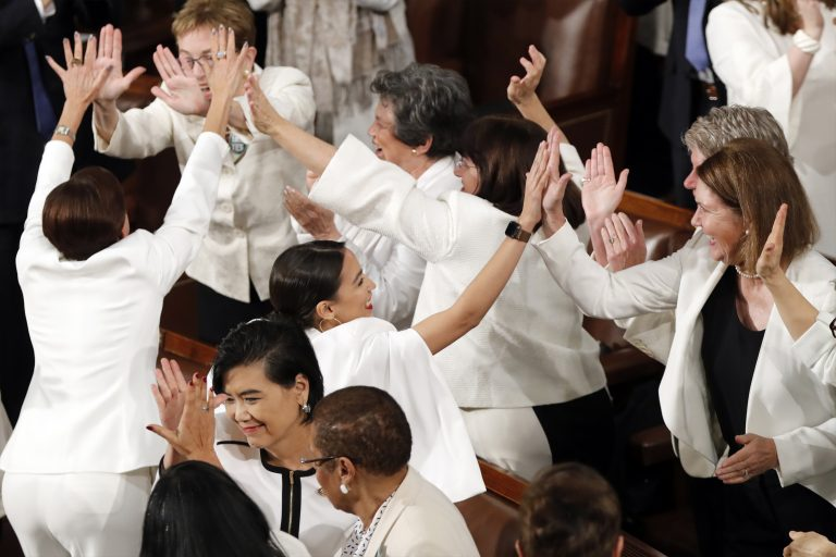 Women members of Congress, including Rep. Alexandria Ocasio-Cortez, D-N.Y., center, cheer after President Donald Trump acknowledges more women in Congress during his State of the Union address to a joint session of Congress on Capitol Hill in Washington, Tuesday, Feb. 5, 2019. (J. Scott Applewhite/AP Photo)