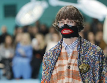 In this Feb. 21, 2018, file photo, a model wears a creation as part of the Gucci women's Fall/Winter 2018-2019 collection, presented during the Milan Fashion Week, in Milan, Italy. Gucci, which designed this face warmer, reminiscent of blackface prompted an instant backlash from the public and forced the company to apologize publicly on Wednesday, Feb. 6, 2019. (Antonio Calanni/AP Photo)