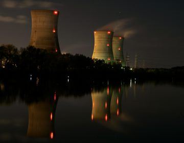 In this file photo from Nov. 2, 2006, cooling towers of the Three Mile Island nuclear power plant are reflected in the Susquehanna River in this time exposure photograph in Middletown, Pa. (Carolyn Kaster/AP Photo)