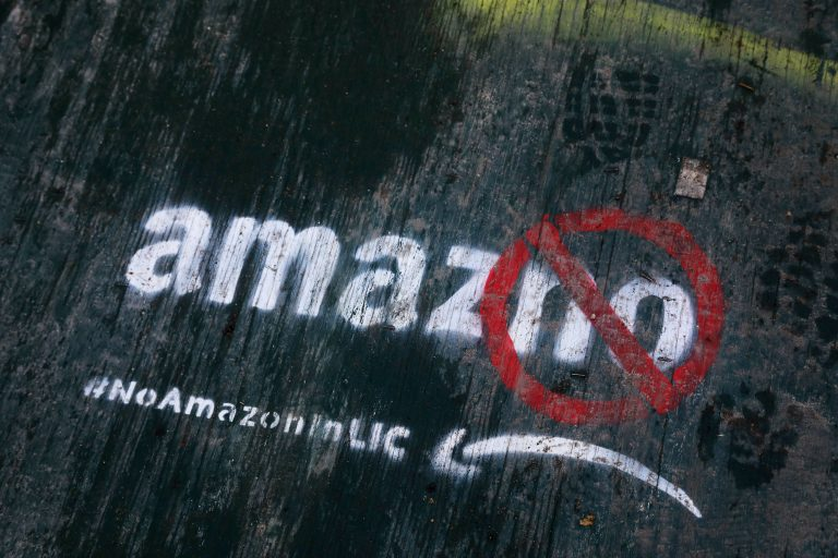 In this Nov. 16, 2018, file photo graffiti has been painted on a sidewalk by someone opposed to the location of an Amazon headquarters in the Long Island City neighborhood in the Queens borough of New York. Local opposition to the proposed Amazon campus grew quickly with grievances that the deal was done secretively; Amazon didn't need nearly $3 billion in tax incentives; and rising rents could push people out of the neighborhood. (Mark Lennihan/AP Photo, File)